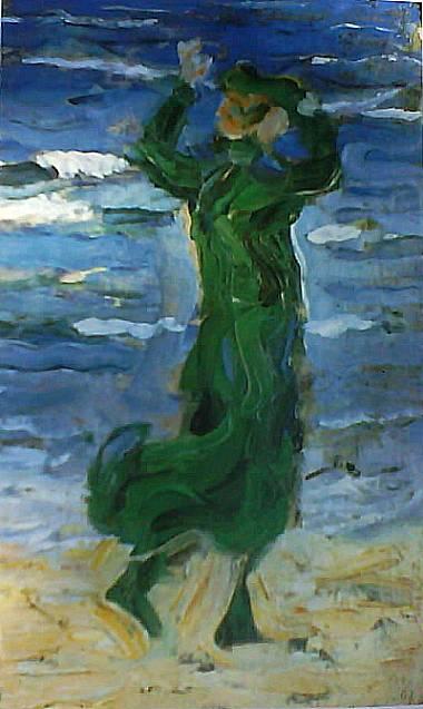 Mujer al viento junto al mar